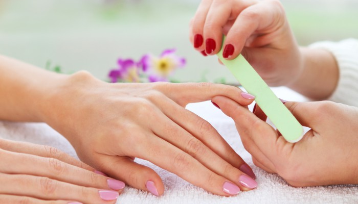 Gentle care of nails in the beauty salon. Close up